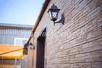 Фасадные панели Деке Stein Осенний лес, Откосы металл RAL 8017, водосточная система Деке Premium Шоколад, соффиты Деке Шоколад.